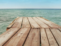 Wooden dock and Mediterranean sea with sky Stock Photos