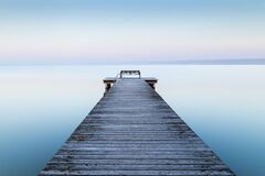 Free Wooden Dock Near The Sea With The Fog In The Background Royalty Free Stock Photos - 171626908