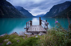 Wooden dock at norwegian lake Stock Photography