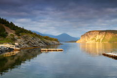 Wooden dock. In a peaceful bay in Newfoundland, Canada Stock Photo