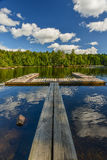 Wooden Dock on a perfect calm lake stock photos