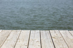 Wooden dock on a pond Stock Images