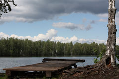 Wooden dock at the river. Royalty Free Stock Image
