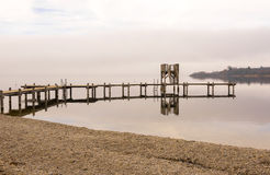 Wooden Dock With Shore During Winter Season Stock Photography