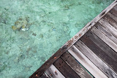 Wooden dock triangle over clear water. Sea , there is coral under water Stock Images