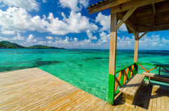 Wooden Dock and Turquoise Water. Wooden dock in Caribbean sea with beautiful turquoise and blue water in San Andres y Providencia, Colombia Royalty Free Stock Photos