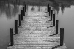 Wooden dock in waters Stock Photo