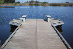 Wooden dock in wet marshland Royalty Free Stock Photography