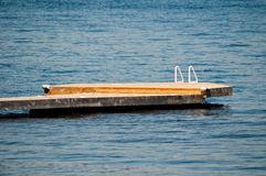 Wooden dock with a white ladder Stock Photography