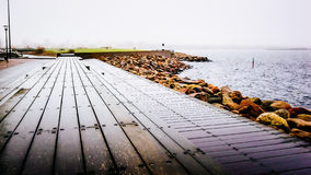 Wooden docks by the sea in Malmo in Sweden on a cloudy day.  Royalty Free Stock Images