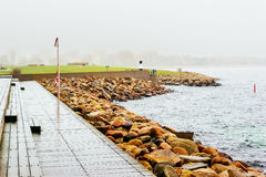 Wooden docks by the sea in Malmo in Sweden on a cloudy day.  Stock Image
