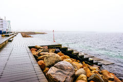 Wooden docks by the sea in Malmo in Sweden on a cloudy day.  Royalty Free Stock Photo