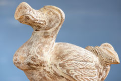 Wooden Dodo bird - typical souvenir from Mauritius island over the blue background. Stock Image