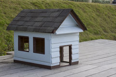 Wooden dog house. Blue wooden dog house stock photography