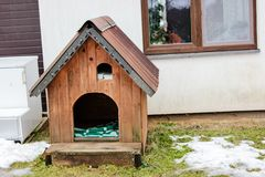 A wooden dog`s house in February 2019 stock images