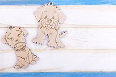 Wooden dogs on striped background. Decoration for a winter holiday. New Year of the Dog stock photos