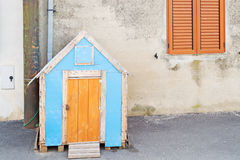 Wooden dohouse. Wooden doghouse in the street royalty free stock images