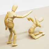 Wooden Doll in Action. Wooden Dolls in Concept of Aggression and Domination Stock Photography