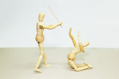 Wooden Doll in Action. Wooden Dolls in Concept of Aggression and Domination Stock Images