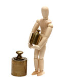 Wooden doll with balance weight Stock Photos