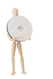 Wooden doll with CD or DVD Royalty Free Stock Images