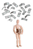 Wooden doll with coins and dollars Stock Image