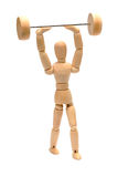 Wooden doll doing weight lifting Stock Images
