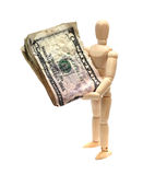 Wooden doll with dollars Stock Image