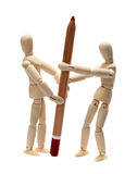 Wooden doll fighting about red pencil Stock Photography