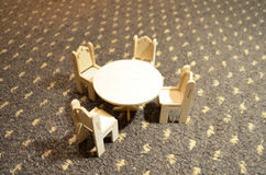Wooden doll furniture, table and chairs Stock Image