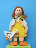 Wooden doll with gander Stock Images