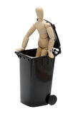 Wooden doll in garbage bin Royalty Free Stock Photos