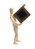 Wooden doll holding semiconductor. On white Royalty Free Stock Photography