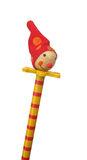 Wooden doll jester on stick with red hat Stock Photography