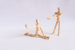 A wooden doll man exercises with his friend Stock Image