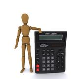 Wooden doll-man holding a calculator Royalty Free Stock Images