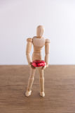 A wooden doll man in valentine day. Showing love on the wooden floor with warmth. Stock Images