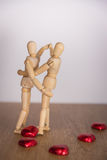 A wooden doll man in valentine day. Showing love on the wooden floor with warmth. Stock Photos