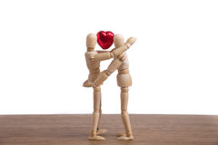 A wooden doll man in a valentine theme show his love to his couple Royalty Free Stock Photos