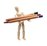 Wooden doll with pencils Royalty Free Stock Photos