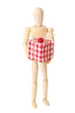 Wooden doll with present Stock Photo