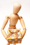 Wooden doll present Royalty Free Stock Image