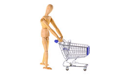 Wooden doll with shopping cart Stock Images
