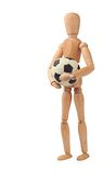 Wooden doll with soccer ball Royalty Free Stock Image