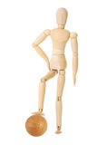 Wooden doll with soccer ball Stock Images