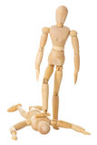 Wooden doll stands on another wooden doll Stock Images