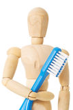 Wooden doll with toothbrush Royalty Free Stock Photo