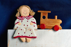 Wooden doll and train Royalty Free Stock Photo