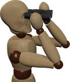 Wooden doll using binoculars Royalty Free Stock Image