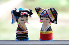 Wooden dolls. Cute wooden girl dolls,a nice souvenir Royalty Free Stock Photography